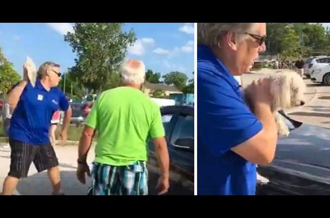 真夏日の中、カギの閉められた車の中に置き去りにされた1匹の犬